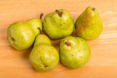Green Bartlett Pears on Wood Table Stock Images