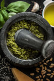 Green basil pesto - italian recipe ingredients on black chalkboard Stock Photography