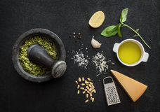 Green basil pesto - italian recipe ingredients on black chalkboard Royalty Free Stock Photo