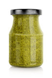 Green basil pesto jar Stock Photo