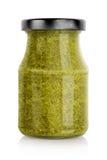 Green basil pesto jar stock photo