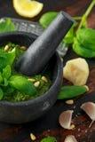 Green Basil Pesto in marble mortar with parmesan cheese, pine nuts, garlic and lemon. Green Basil Pesto in marble mortar with parmesan cheese, pine nuts, garlic royalty free stock photo