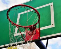 Green baskeetball ring with a net Stock Photography