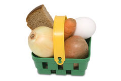 Green basket with food. Basket shopping daily needs stock images
