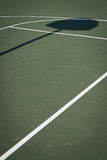 Green basketball court with hoop shadow royalty free stock photos