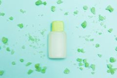 Green bath salt and aromatic oil on a blue background stock photos