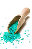 Green bath salt with wooden scoop Royalty Free Stock Photos