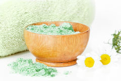 Green bath salts in a wooden bowl Stock Image
