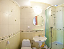 Green bathroom. Wide angle view of a green tiled bathroom Stock Photos