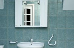 Green bathroom detail with mirror Royalty Free Stock Photos