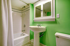 Green bathroom with white tile trim Royalty Free Stock Image