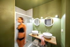 Green bathroom with woman in underwear stock image