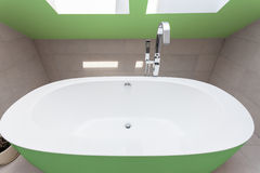 Green bathtub in bathroom Royalty Free Stock Images