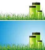 Green Batteries. Recyclable batteries on a nature setting Royalty Free Stock Photography