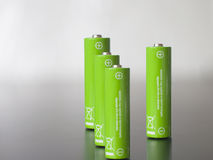 Green batteries. Save energy concept on the black background Stock Photo