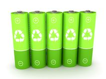 Green battery over white background Stock Photo