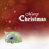 Green Bauble with Christmas greeting on red Royalty Free Stock Photos