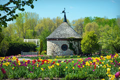 Green Bay Botanical Garden. A round stone building with tulips blooming at the Green Bay Botanical Garden in Green Bay, WI royalty free stock photos