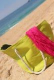 Green beach bag on the beach Stock Photo