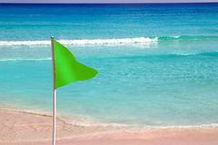 Green beach flag good beach weather Royalty Free Stock Images