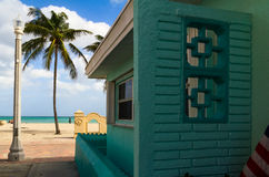 Green beach house and palm tree Stock Images
