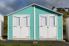 Green Beach huts. In England Stock Photos