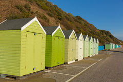 Green beach huts in a row with blue sky Stock Image