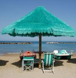 Green Beach Umbrella with Boats Royalty Free Stock Images