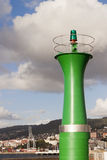 Green beacon in Vigo port. Royalty Free Stock Photos