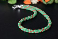 Green beaded necklace with candy cane print Stock Image