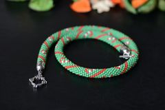 Green beaded necklace with candy cane print Stock Photos