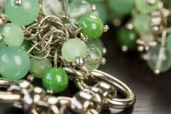 Green beads on an item of silver jewellery Stock Photos