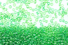 Green beads on white Royalty Free Stock Photos
