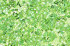 Green beads on white Stock Images
