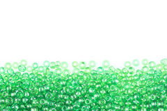 Green beads on white Royalty Free Stock Photography