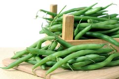 Green bean. With crate on cutting board royalty free stock photography