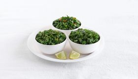 Green Bean Curry South Indian Vegetarian Side Dish in Bowls. Green bean curry, a south Indian traditional and popular vegetarian side dish in three bowls on a royalty free stock images