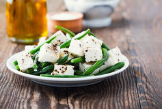 Green bean and feta salad. On wooden background royalty free stock photos