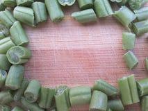 Green bean frame on wooden background Stock Photos