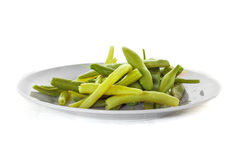 Green bean plate. On white background Stock Photography