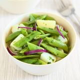Green Bean, Potato and Onion Salad. Green bean, potato and red onion salad with parsley, photographed with natural light Selective Focus, Focus in the middle of stock image
