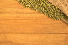 Green bean pour out of grunge sack Royalty Free Stock Images