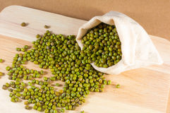 Green bean in sack on wood background Royalty Free Stock Photos