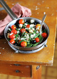 Green bean salad with roasted cherry tomatoes, black olives and salted feta Royalty Free Stock Images