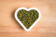 Green bean seed in a heart shape block Royalty Free Stock Photography