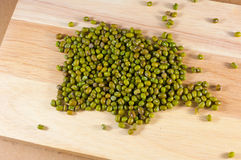 Green bean seed on wood background Royalty Free Stock Photo
