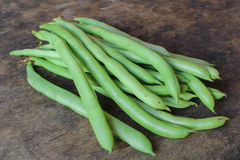 Green bean. On wooden background royalty free stock photo