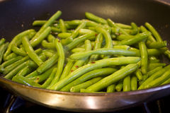 Green Beans. Being cooked in a pan royalty free stock photos