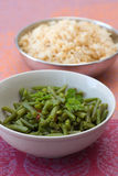 Green Beans. Bowls with green beans and rice which are cooked in Indian style stock images