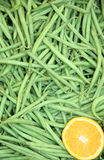 Green beans. Background of green beans and orange Royalty Free Stock Photography